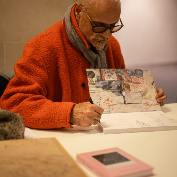 "Fereydoun Ave signing his book, ""Fereydoun Ave: half a century"" at the British Museum"