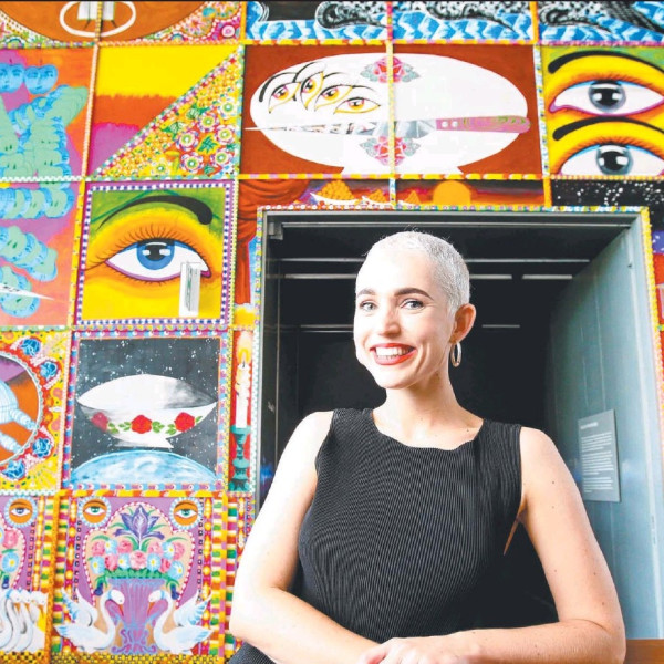 WONDER WALL: Jaala Alex, of New Farm, in front of Iranian artist Iman Raad's Days of bliss and woe at GOMA. Picture: AAP/Steve Pohlner